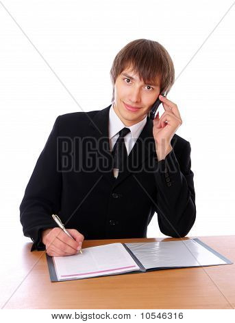 Businessman Is Talking On The Phone And Sign Documents