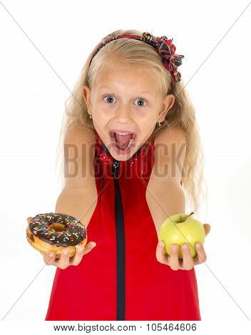 Little Beautiful Blond Child Choosing Dessert Holding Unhealthy Chocolate Donut And Apple Fruit