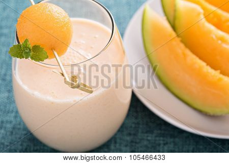 Healthy cantaloupe smoothie in a glass
