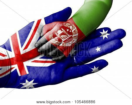 Adult Man Holding A Baby Hand With Australia And Afghanistan Flags Overlaid. Isolated On White
