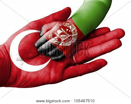 Adult Man Holding A Baby Hand With Turkey And Afghanistan Flags Overlaid. Isolated On White