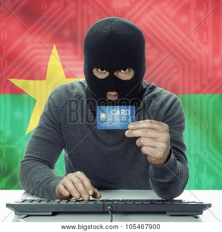 Dark-skinned Hacker With Flag On Background Holding Credit Card - Burkina Faso