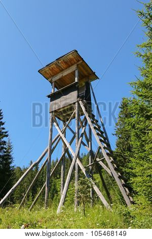 An elevated wooden platform known as Tree stand or Deer stand on mountain for hunters to have a better sight
