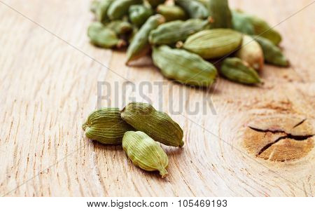 Green Cardamom Pods On Wooden Background