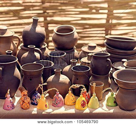 Ethnic background texture, art. Exposition of jugs, vases, pots