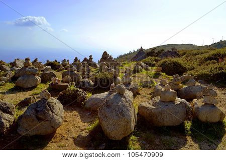 Stones balancing on top of Foia the highest mountain of Algarve, Portugal