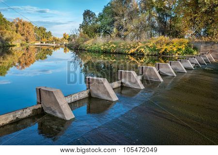 river diversion dams providing water for farming - Cache la Poudre River near WIndsor, Colorado, autumn scenery