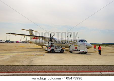 VERONA, ITALY - SEPTEMBER 15, 2014: ATR-72 in Verona airport. The ATR 72 is a twin-engine turboprop short-haul regional airliner built by the French-Italian aircraft manufacturer ATR