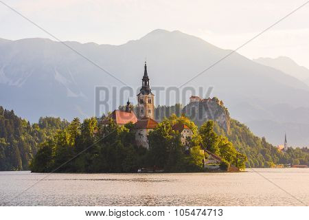 Catholic Church In Bled Lake And Bled Castle, Slovenia At Sunrise