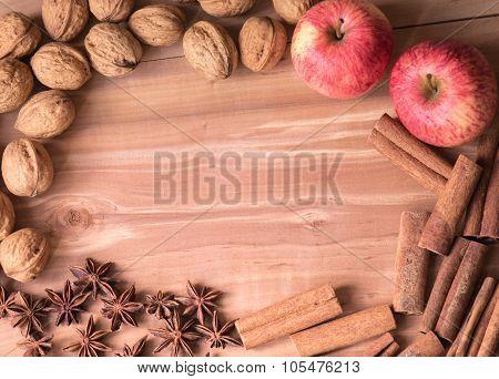 Background walnuts, apples,  stars aniseed, sinnamon