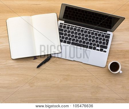 An open notebook with a pen and notebook with coffee Cup on a light wooden table. Picture with space for your text.