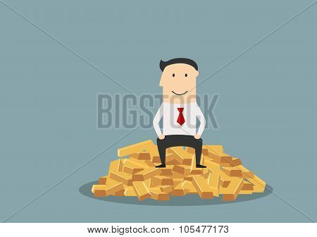 Businessman sitting on a gold bars