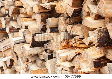 firewood.  Dry firewoods in a pile for furnace kindling