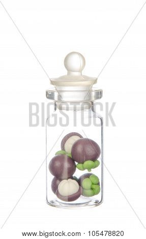 Artificial Mangosteen In The Bottle Isolated On White Background