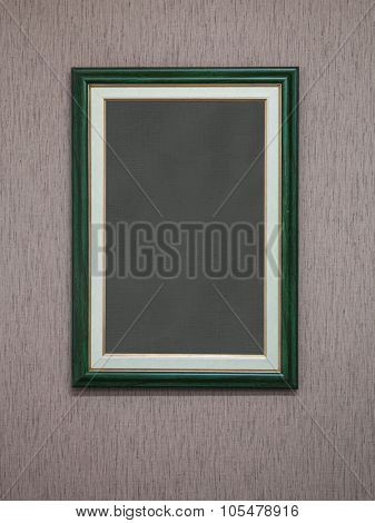 Dark green frames on old wall