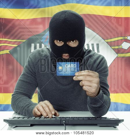 Dark-skinned Hacker With Flag On Background Holding Credit Card - Swaziland