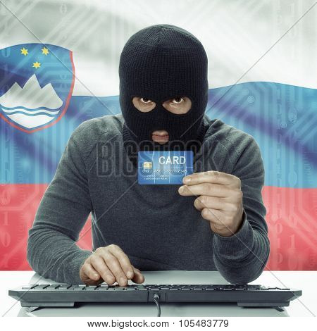 Dark-skinned Hacker With Flag On Background Holding Credit Card - Slovenia