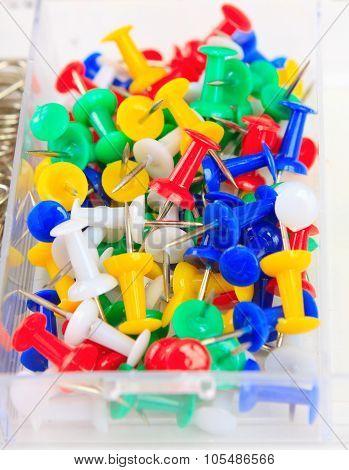 Colorful Thumbtacks In The Box