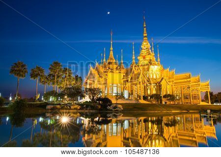 The beautiful golden buddhist temple in night time at Nakhon Ratchasima Thailand (Treasure of Buddhi