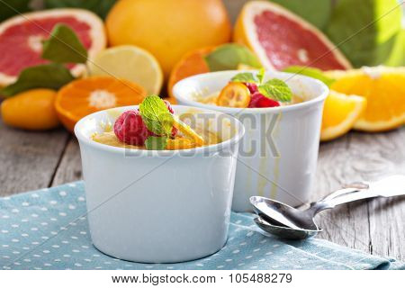 Citrus pudding in white ramekins