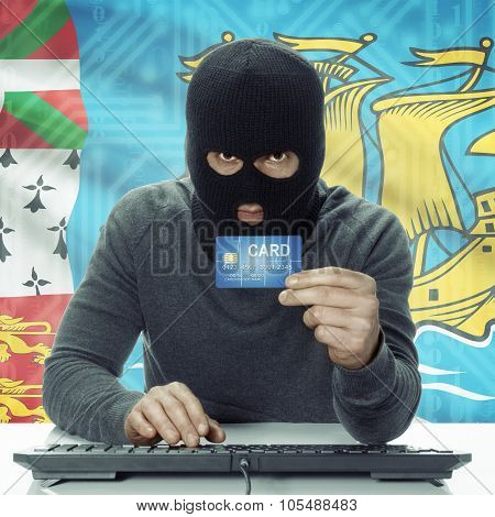 Dark-skinned Hacker With Flag On Background Holding Credit Card - Saint-pierre And Miquelon