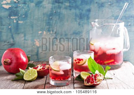 Pomegranate cocktail with lime slices