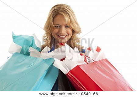 Close-up portrait of woman with shopping bags