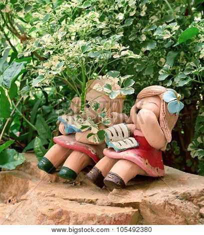 Luaghing Sound Of Earthen Girl Dolls Under Plants