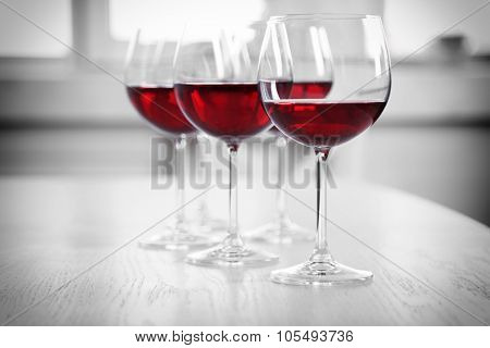 Wine glasses in restaurant on light background
