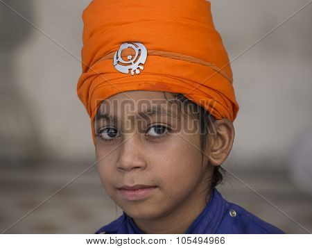 Sikh Boy Visiting The Golden Temple In Amritsar, Punjab, India.