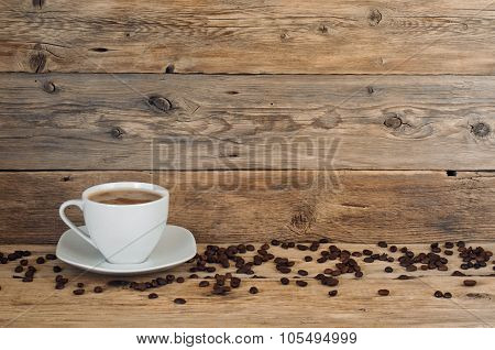 Cup Of Coffee With Scattered Coffee Grains