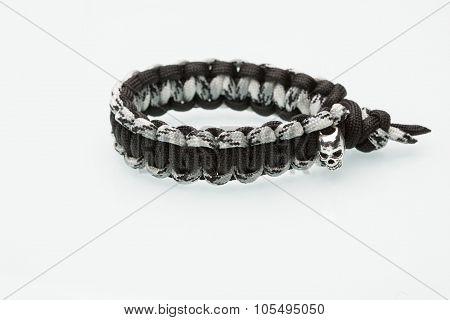 Black braided bracelet on white background