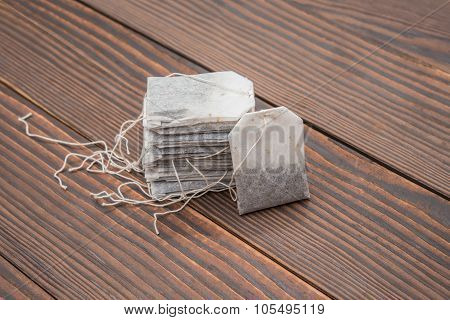 Teabags On A Wooden Background