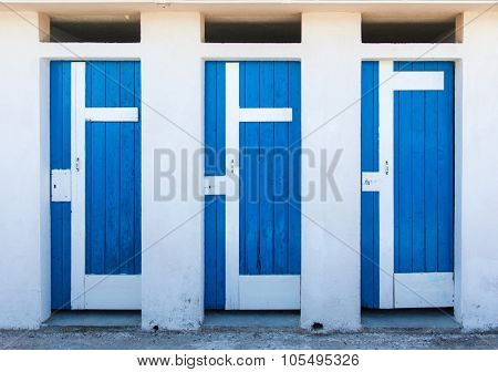 Three blue doors next to each other