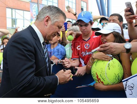 American actor, producer, and comedian Alec Baldwin signing autographs at the red carpet