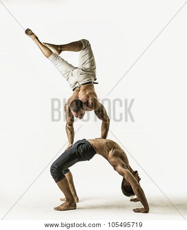 Male Acrobatic Dancers Balancing in Studio