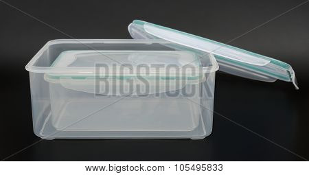 Translucent Storage Boxes With Lip Opened On A Black Background