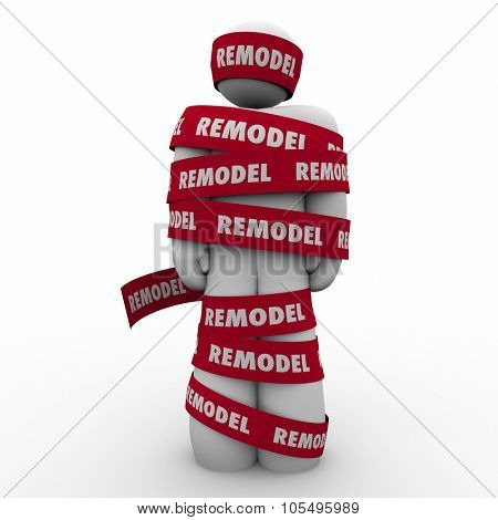 Remodel word on red tape wrapped around a home or property owner during a renovation or building improvement project