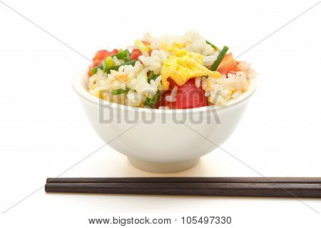 Chinese Cuisine - Homemade Fried Rice With Tomatoes And Egg With Chop Sticks On White With Clipping