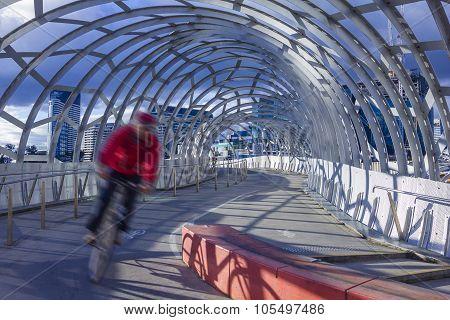 Man Cycling Along The Webb Bridge In Melbourne