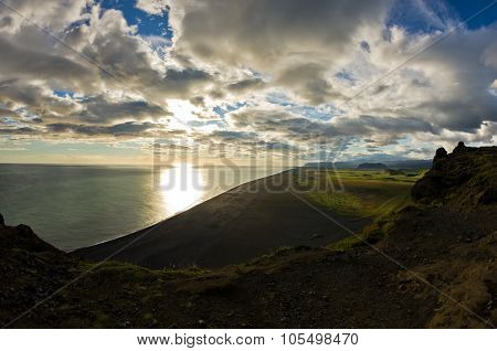 Sunset on a black beach, a view from Dyrholaey rock, Iceland