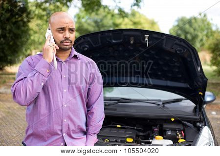 man calling breakdown service