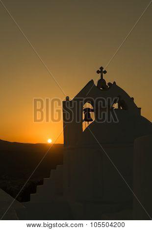Beautiful orthodox church Saint Antony in Paros island in Greece against the sunset.