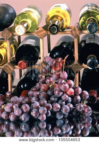 Wine Bottles And Grapes.