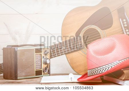 Old Transistor Radio And Acoustic Guitar On Wooden Background, Made With Color Filters,blurred Focus