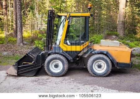 Yellow Forklift With General Bucket Stands