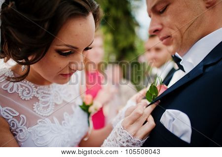 Bride Groom Wears A Buttonhole