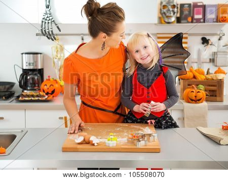 Halloween Dressed Girl With Mother Cutting Out Cookies