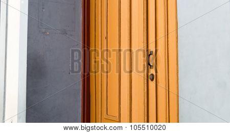 Antique orange door on the city of Ouro Preto, Minas Gerais, Brazil