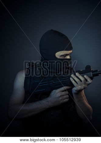 Criminal, terrorist carrying a machine gun and balaclava